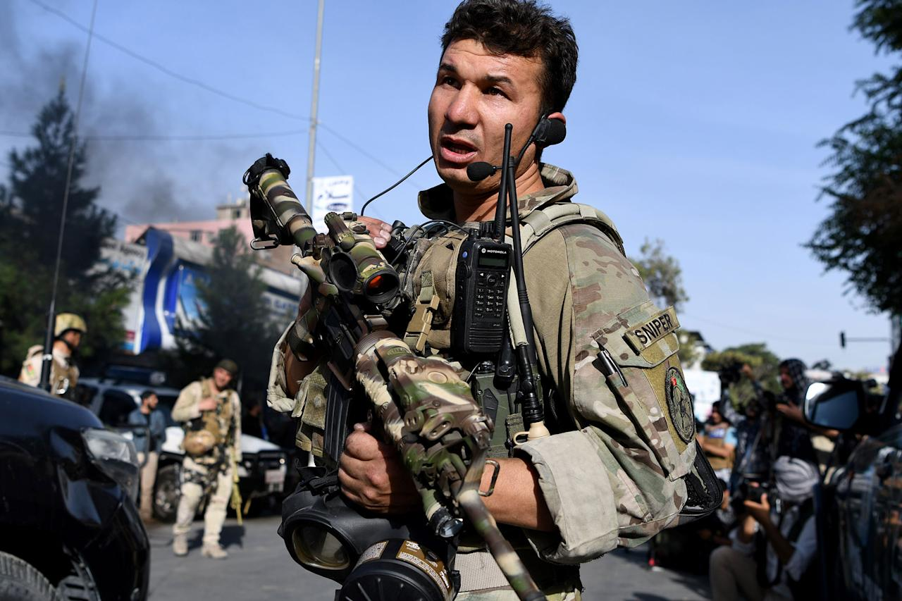 <p>Afghan security personnel leave the Iraqi embassy building after an attack in Kabul on July 31, 2017.<br /> A suicide bomber blew himself up outside the Iraqi embassy in Kabul July 31 and militants breached the compound, Afghan officials said, in a complex hours-long attack claimed by the Islamic State group. (Wakil Kohsar//AFP/Getty Images) </p>
