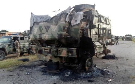 FILE PHOTO: A damaged military vehicle is pictured in the northeast town of Gudumbali, after an attack by members of Islamic State in West Africa