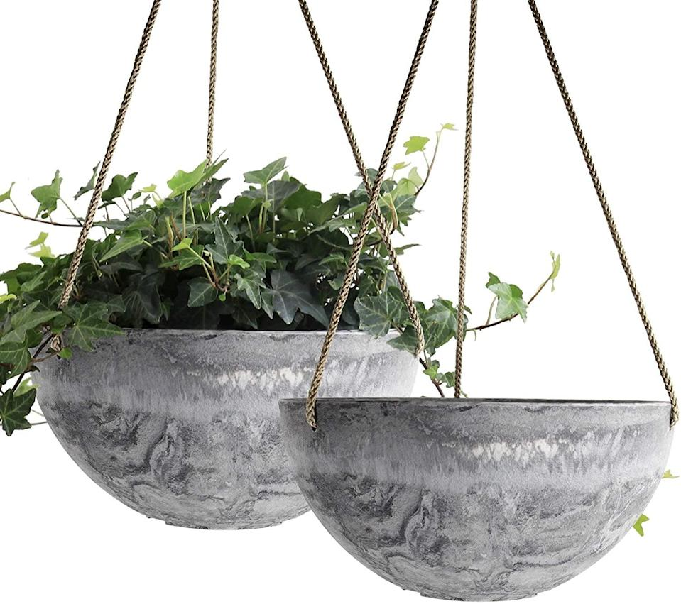 <p>The marble print of the <span>Hanging Planter Pots, Set of 2</span> ($30) is mesmerising. </p>
