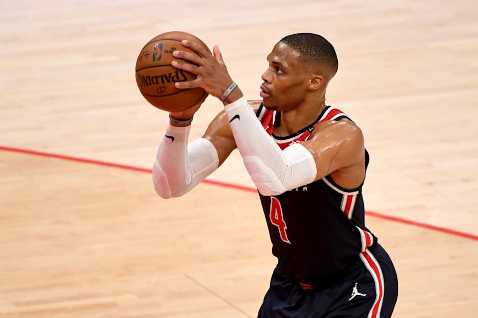 Russell Westbrook with the ball in his hands in a shooting motion.