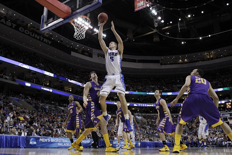 Duke's Mason Plumlee (5) goes up for a shot against Albany's John Puk (44) during the first half of a second-round game of the NCAA college basketball tournament, Friday, March 22, 2013, in Philadelphia. (AP Photo/Matt Slocum)