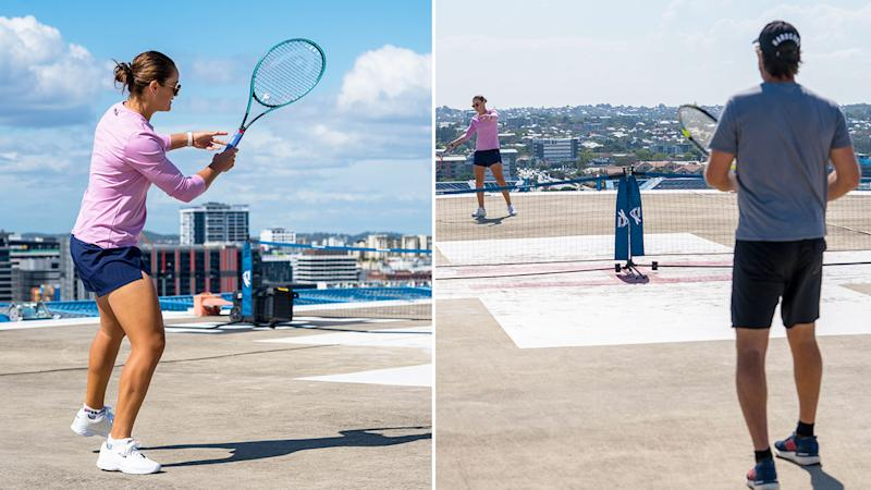 Seen here, Ash Barty and Pat Rafter have a hit of tennis after visiting a Brisbane hospital.