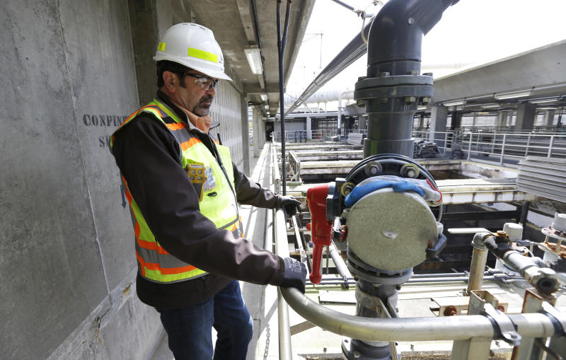 In this March 16, 2017 photo, Robert Waddle, division operations manager at the West Point Treatment Plant in Seattle, stands near a closed valve next to empty pools normally used to remove grit and other solids from sewage and storm water. The plant is still recovering from an equipment failure that crippled operations and caused millions of gallons of raw sewage and untreated runoff to pour into the United States' second largest estuary. (AP Photo/Ted S. Warren)