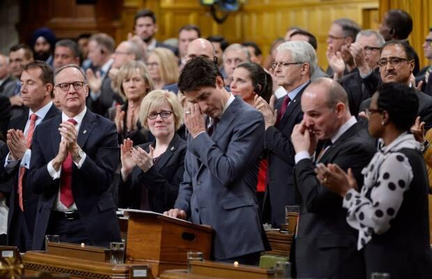 Prime Minister Justin Trudeau wipes his eye as he delivers a formal apology to LGBTQ people in Canada in the House of Commons in Ottawa, Tuesday, Nov. 28, 2017.