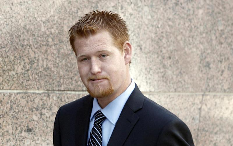 Redmond O'Neal arrives at court Thursday Dec. 12, 2013, to testify in the case of an Andy Warhol portrait of Farrah Fawcett in Los Angeles. Attorneys for Ryan O'Neal concluded their case in the actor's bid to keep a version of the portrait of Fawcett on Thursday. The former couple's son Redmond, was among the final witnesses. The University of Texas at Austin is suing Ryan O'Neal to try to gain possession of the portrait. Fawcett left all her artwork to the school and it claims O'Neal improperly took it from her condo days after her death. (AP Photo/Nick Ut)