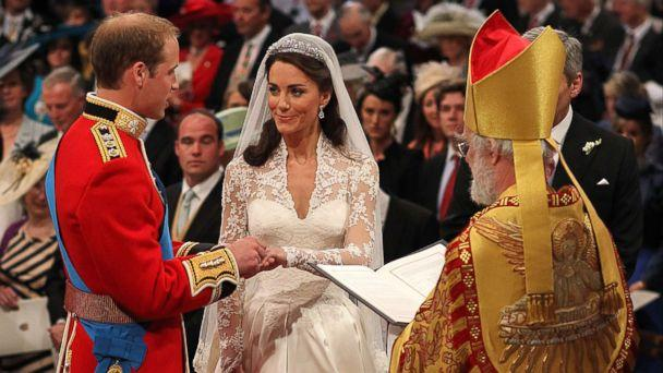 PHOTO: Britain's Prince William and Kate Middleton exchange rings in front of the Archbishop of Canterbury at Westminster Abbey, London, April 29, 2011. (Dominic Lipinski/AP Photo)