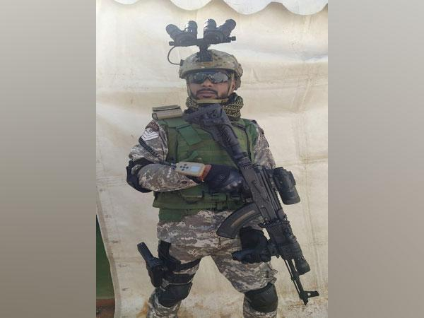 A CRPF commando wearing four-eyed night vision goggles