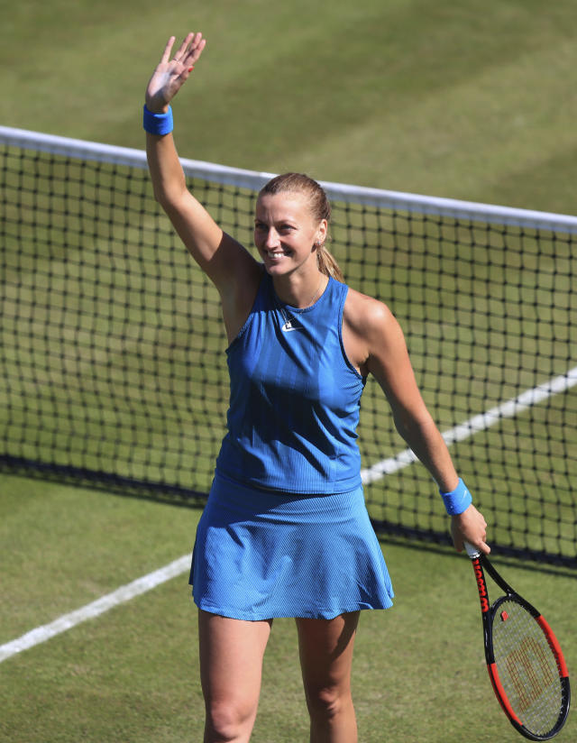 Czech Republic's Petra Kvitova celebrates winning her quarter final tennis match against Germany's Julia Goerges during day five of the Nature Valley Classic at Edgbaston Priory, Birmingham, England, Friday June 22, 2018. (Simon Cooper/PA via AP)