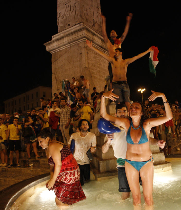 Italian soccer fans celebrate in Piazza del Popolo square in Rome, after Italy's victory against Germany in the Euro 2012 soccer championship semifinal match Thursday, June 28, 2012. (AP Photo/Alessandra Tarantino)