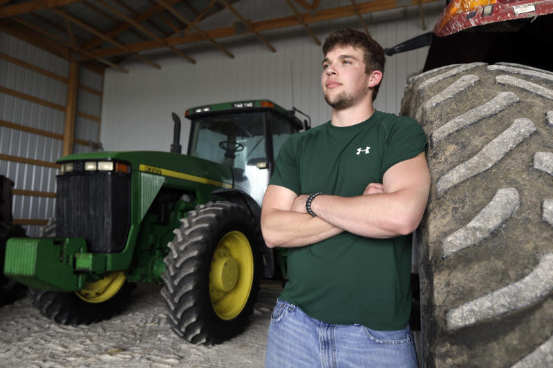 In this Wednesday, April 17, 2013 photo, Jake Anderson poses for a photo in an equipment shed on his family's farm in Williamsburg, Mo. Anderson didn't have to delve too deep into the University of Missouri's agricultural economics program before realizing he was destined to return to the 1,500-acre family farm. After all, that's been the Anderson family trade since 1891. (AP Photo/Jeff Roberson)
