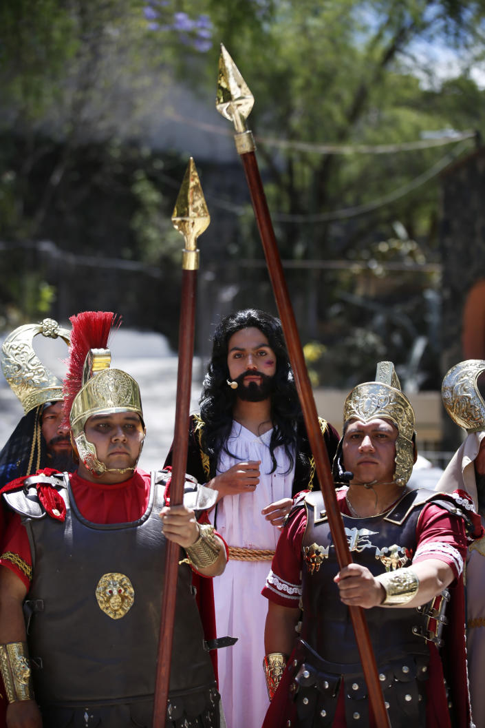Men dressed as Roman soldiers escort Brando Neri Luna in the role of Jesus Christ during the Passion Play of Iztapalapa, outside the Cathedral, on the outskirts of Mexico City, Friday, April 2, 2021, amid the new coronavirus pandemic. To help prevent the spread of the COVID-19, Latin America's most famous re-enactment of the crucifixion of Christ was closed to the public and transmitted live so people could watch at home, for a second consecutive year. (AP Photo/Marco Ugarte)
