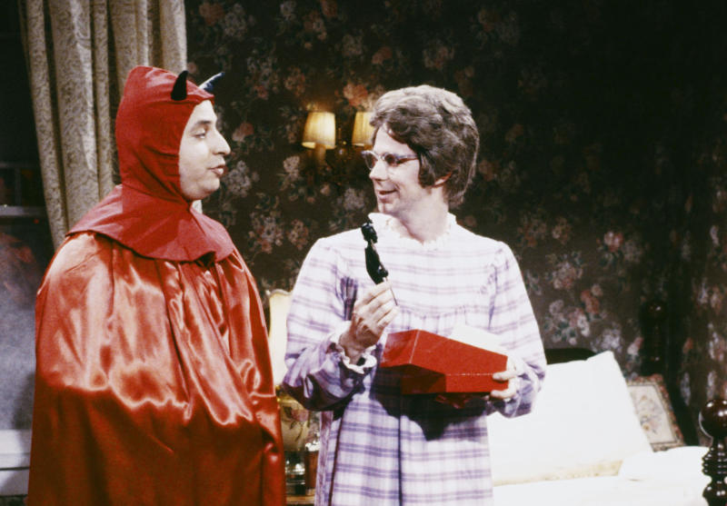 SATURDAY NIGHT LIVE -- Episode 9 -- Pictured: (l-r) Jon Lovitz as Mephistopheles, Dana Carvey as Chuch Lady during the 'Christmas Eve' skit on December 17, 1988 (Photo by NBCU Photo Bank/NBCUniversal via Getty Images via Getty Images)