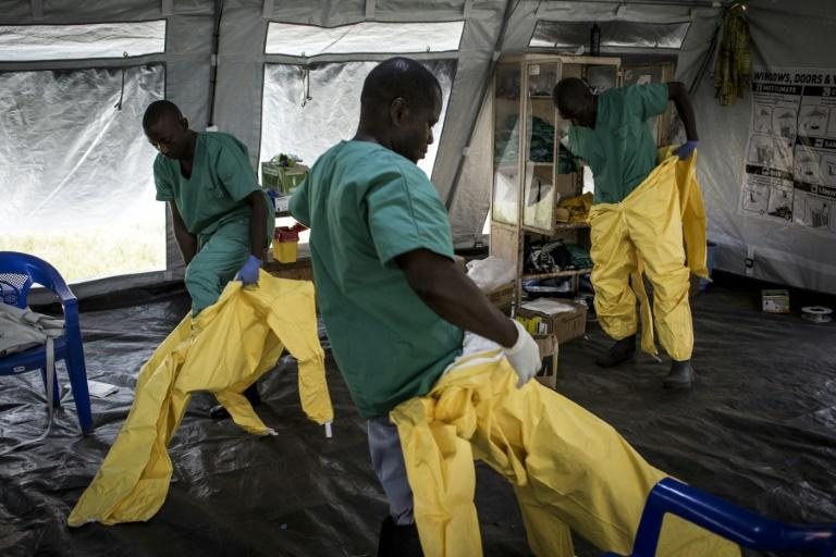 Virus threat: Medical workers in Beni don full protective gear -- not for COVID-19 but for Ebola. The deadly haemorrhagic fever broke out in North Kivu nearly 21 months ago (AFP Photo/John WESSELS)