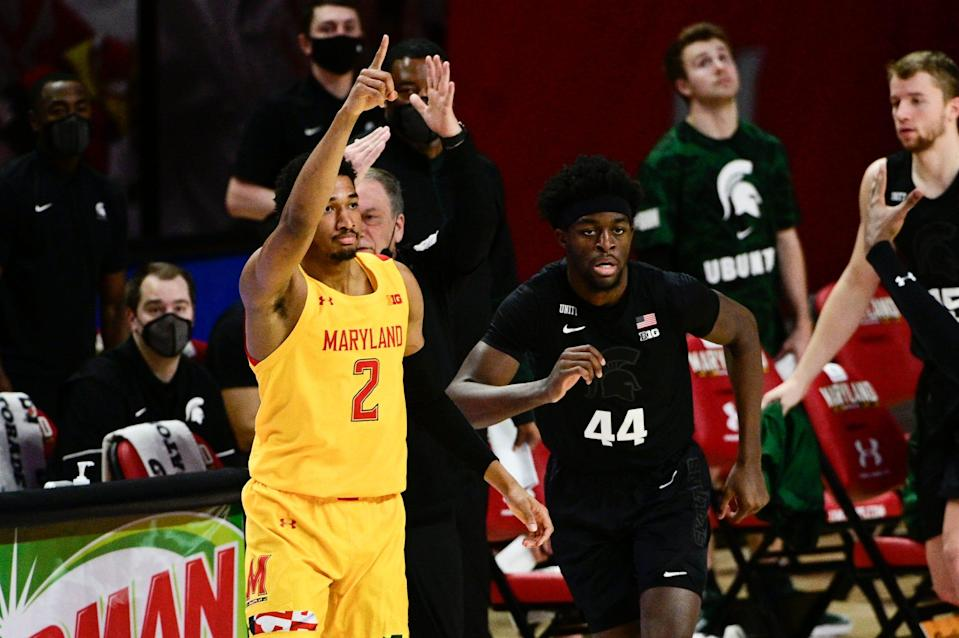 Maryland guard Aaron Wiggins reacts after making a 3-pointer, as Michigan State forward Gabe Brown runs down the court during the first half at Xfinity Center, Feb. 28, 2021 in College Park, Md.