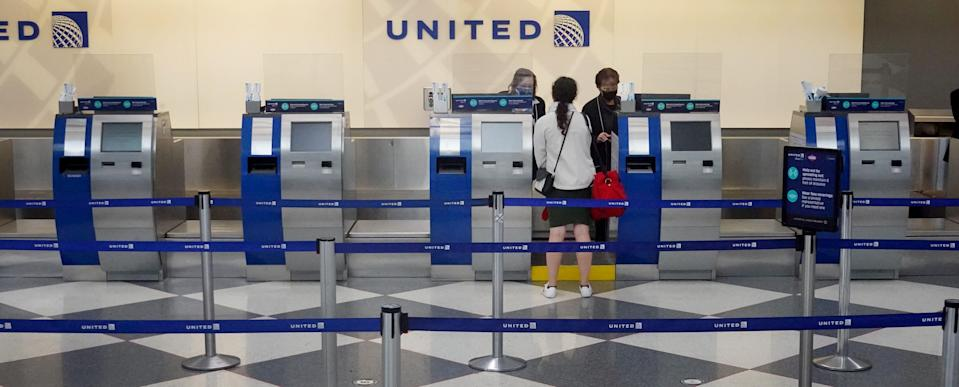 A traveler checks in for a flight at O'Hare International Airport on Nov. 24, 2020, in Chicago.