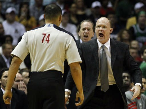 Milwaukee Bucks Head coach Scott Skiles, right, argues a call by official Curtis Blair (74) during the first half of an NBA basketball game against the Boston Celtics, Thursday, March 22, 2012, in Milwaukee. (AP Photo/Jeffrey Phelps)