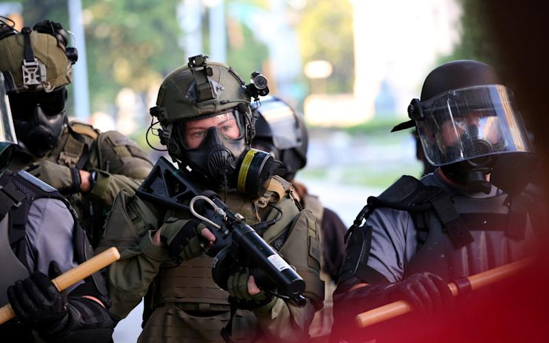 Members of the US National Guard have also been given rubber bullet guns - Dustin Chambers/Reuters