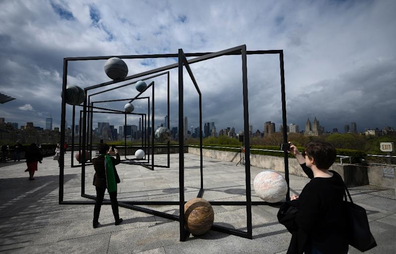"Alicja Kwade's ""ParaPivot"" will be on display in the roof garden of the Metropolitan Museum of Art in New York through October 27, 2019 (AFP Photo/Johannes EISELE)"