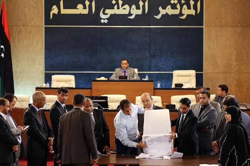 File picture shows members of Libya's General National Congress (GNC) in Tripoli attending the first round of voting to elect the new congress president on June 25, 2013 (AFP Photo/Mahmud Turkia)