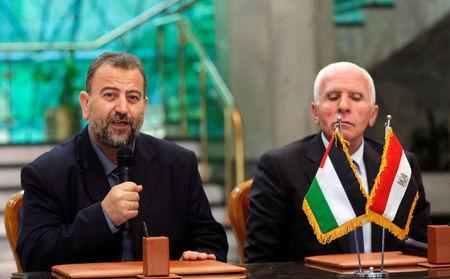 Head of Hamas delegation Saleh Arouri speaks as he attends a news conference with Fatah leader Azzam Ahmad after a reconciliation deal signing ceremony in Cairo, Egypt, October 12, 2017. REUTERS/Amr Abdallah Dalsh