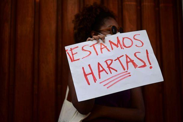PHOTO: A member of a feminist collective holds a sign that reads in Spanish 'We are fed up' during a demonstration against Sexual Violence, in San Juan, Puerto Rico, May 3, 2021. (Carlos Giusti/AP)