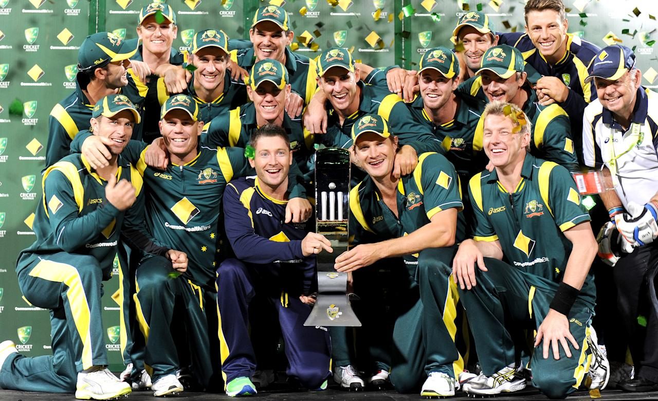The Australian cricket team celebrates with the trophy after defeating Sri Lanka in the final match of the one-day cricket series, in Adelaide on March 8, 2012.  Australia won the match to win the series 2-1.  IMAGE STRICTLY RESTRICTED TO EDITORIAL USE - STRICTLY NO COMMERCIAL USE  AFP PHOTO/William WEST (Photo credit should read WILLIAM WEST/AFP/Getty Images)