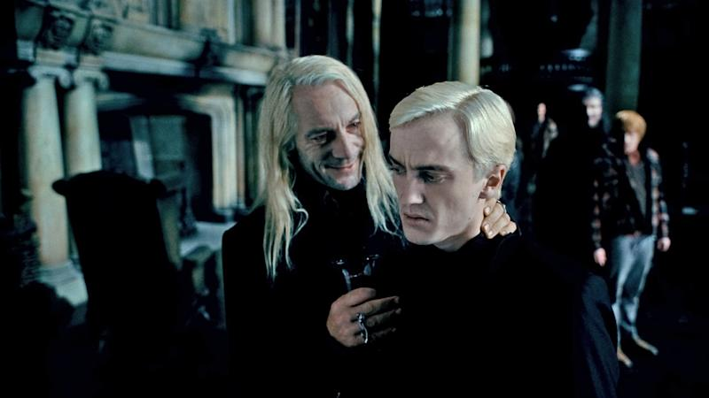 Isaacs and Tom Felton in Harry Potter (Credit: Warner Bros)