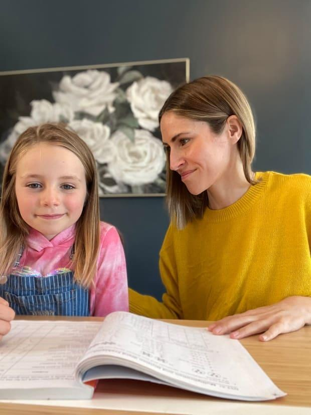 Juliana Hagans has to wait almost a week to get her daughter Charlotte, 8, tested for COVID-19 despite being deemed a close contact of a case in her Calgary elementary school. (Juliana Hagans - image credit)