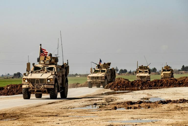 US military armoured vehicles patrol on the outskirts of Tal Tamr town in Syria (AFP Photo/Delil SOULEIMAN)