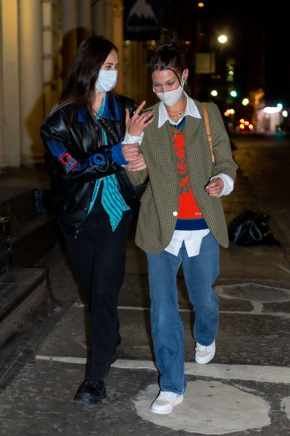 <p>The 23-year-old model was seen walking through the streets of Manhattan with a friend on Monday September 21 wearing a white face mask.</p><p>The star had spent the evening at The Ainsworth restaurant before taking a scooter ride home.</p><p>Hadid wore a laidback look for her night out which included oversized jeans, white trainers, a white shirt, orange jumper and gingham blazer. She teamed the look with a Louis Vuitton handbag.</p><p>The model is due to become an auntie any day now, with sister Gigi expected to give birth this month. </p>