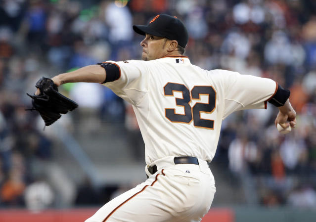 San Francisco Giants starting pitcher Ryan Vogelsong throws to the Los Angeles Dodgers during the first inning of a baseball game Wednesday, April 16, 2014, in San Francisco. (AP Photo/Marcio Jose Sanchez)