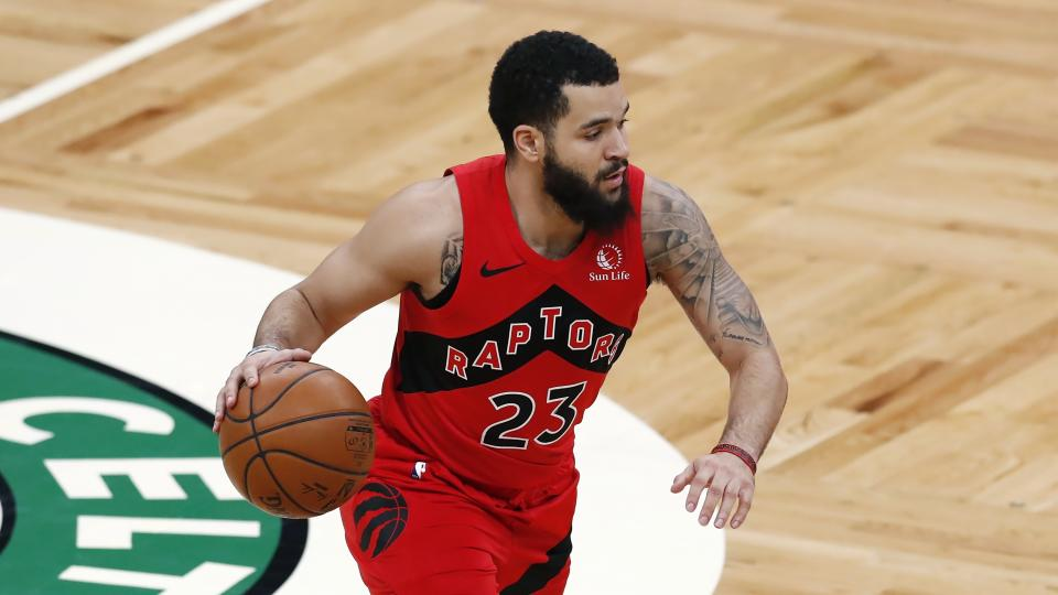 Fred VanVleet dribbles with the ball in one hand during a game.