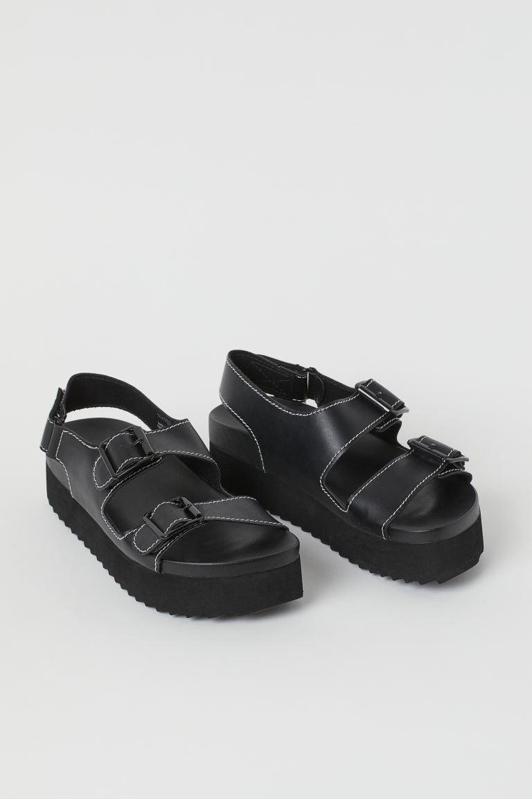 """<h2>Cheap Trendy Sandals</h2><br>Whether you're in search of a <a href=""""https://www.refinery29.com/en-us/best-chunky-sandals"""" rel=""""nofollow noopener"""" target=""""_blank"""" data-ylk=""""slk:lug-soled option"""" class=""""link rapid-noclick-resp"""">lug-soled option</a> with contrast stitching, a <a href=""""https://www.refinery29.com/en-us/fisherman-sandals-trend"""" rel=""""nofollow noopener"""" target=""""_blank"""" data-ylk=""""slk:fisherman-style shoe"""" class=""""link rapid-noclick-resp"""">fisherman-style shoe</a>, or a <a href=""""https://www.refinery29.com/en-us/platform-flip-flop"""" rel=""""nofollow noopener"""" target=""""_blank"""" data-ylk=""""slk:flatform flip-flop"""" class=""""link rapid-noclick-resp"""">flatform flip-flop</a>, you don't have to spend more than $50 for of-the-moment summer footwear.<br><br><strong>H&M</strong> Platform Sandals, $, available at <a href=""""https://go.skimresources.com/?id=30283X879131&url=https%3A%2F%2Fwww2.hm.com%2Fen_us%2Fproductpage.0962399001.html"""" rel=""""nofollow noopener"""" target=""""_blank"""" data-ylk=""""slk:H&M"""" class=""""link rapid-noclick-resp"""">H&M</a>"""