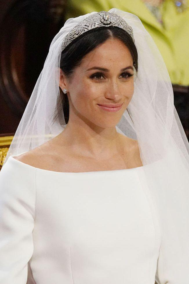 "<p><strong>Wedding date: </strong>May 19, 2018</p><p><strong>Wedding tiara: </strong>Meghan wore the stunning Queen Mary's bandeau tiara for her wedding day. <a href=""https://www.townandcountrymag.com/style/jewelry-and-watches/a20756656/queen-mary-diamond-bandeau-tiara-meghan-markle-royal-wedding/"" rel=""nofollow noopener"" target=""_blank"" data-ylk=""slk:The Queen Mary's bandeau tiara belonged to the Queen's grandmother,"" class=""link rapid-noclick-resp"">The Queen Mary's bandeau tiara belonged to the Queen's grandmother,</a> Queen Mary. The center stone is a brooch featuring 10 diamonds that were gifted to Mary of Teck in 1893. In 1932, the diamond and platinum bandeau tiara was made to accommodate the brooch. The tiara was bequeathed to Elizabeth when Queen Mary died in 1953. <a href=""https://www.townandcountrymag.com/style/jewelry-and-watches/a15908164/meghan-markle-wedding-tiara/"" rel=""nofollow noopener"" target=""_blank"" data-ylk=""slk:Meghan reportedly picked out the tiara"" class=""link rapid-noclick-resp"">Meghan reportedly picked out the tiara</a> for her wedding day with Queen Elizabeth at Buckingham Palace.</p>"