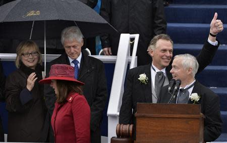 Virginia Governor Terry McAuliffe gives a thumbs up after finishing his inaugural address and being sworn in, in Richmond, Virginia, January 11, 2014. REUTERS/Mike Theiler