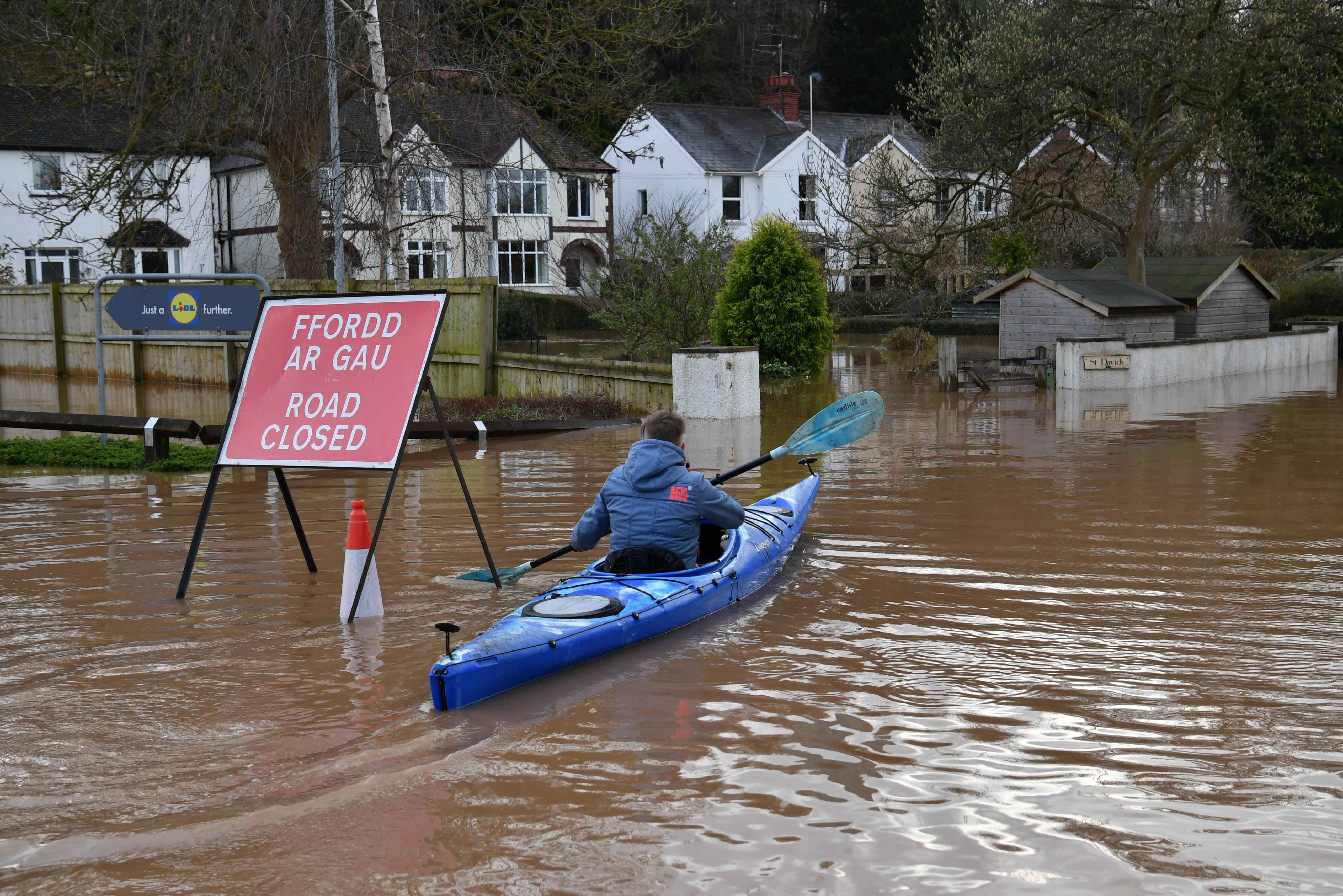 A canoeist makes his way down a road in Monmouth, in the aftermath of Storm Dennis. (Photo by Ben Birchall/PA Images via Getty Images)