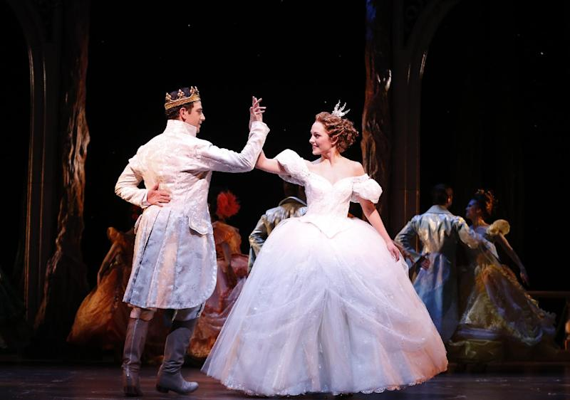 """This theater image released by Sam Rudy Media Relations shows Laura Osnes as Cinderella, right, dancing with Santino Fontana as the Prince, during a performance of """"Rodgers + Hammerstein's Cinderella on Broadway."""" (AP Photo/Sam Rudy Media Relations, Carol Rosegg)"""