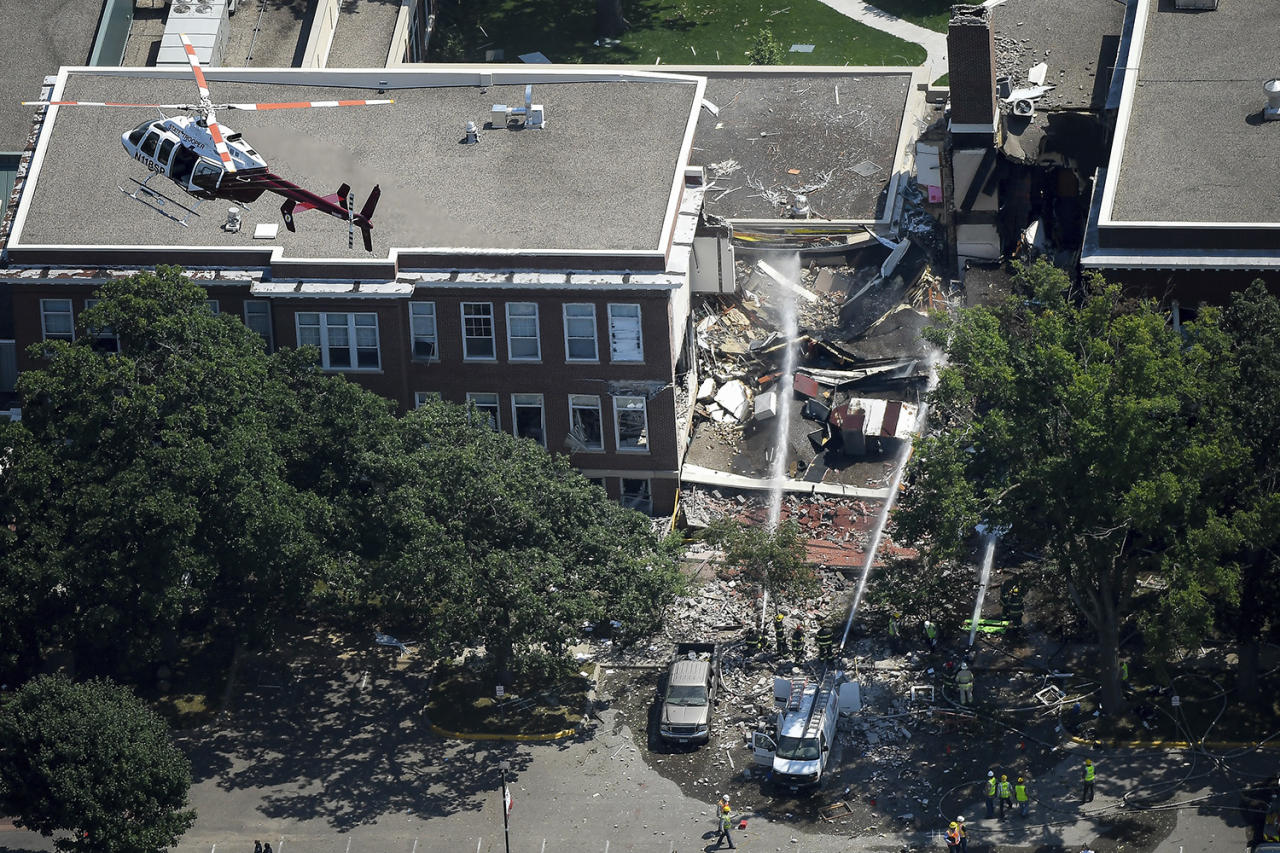 <p>Emergency workers respond to an explosion at Minnehaha Academy in Minneapolis, Aug. 2, 2017. Assistant Fire Chief Bryan Tyner said it appears the explosion may have been caused by a ruptured gas line, but that the investigation is ongoing. (Aaron Lavinsky/Star Tribune via AP) </p>