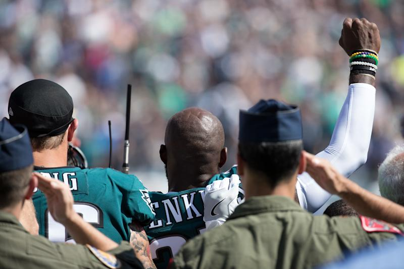 Philadelphia Eagles strong safety Malcolm Jenkins (27) and defensive end Chris Long (56) stand for the anthem prior to a game against the New York Giants on Sunday. (Bill Streicher/USA Today Sports via Reuters)