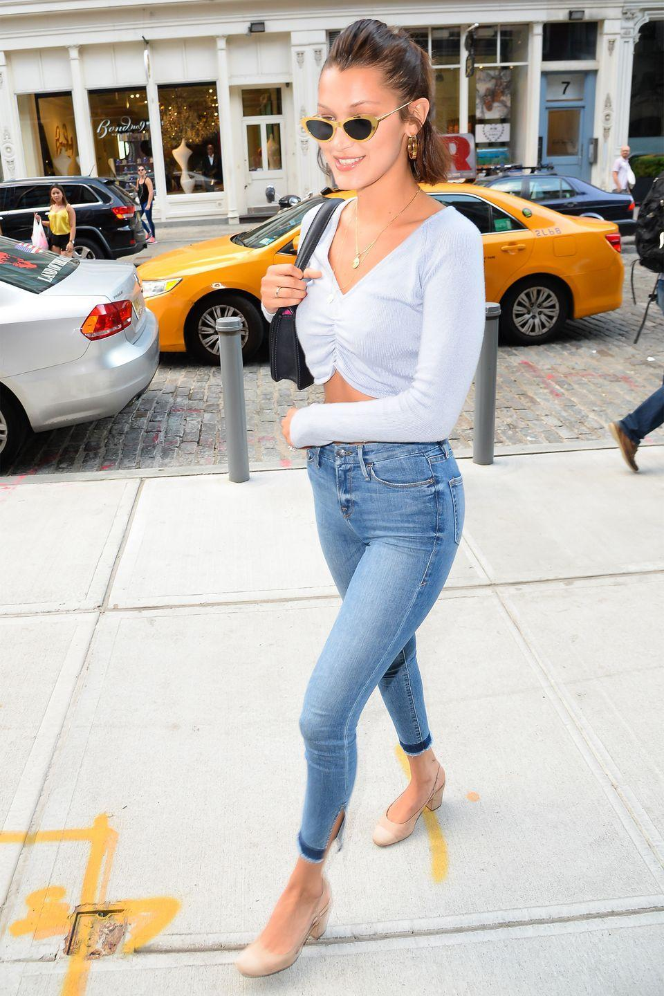 <p>In Good American jeans, a crop top, retro shades and carrying a Dior bag in NYC. </p>