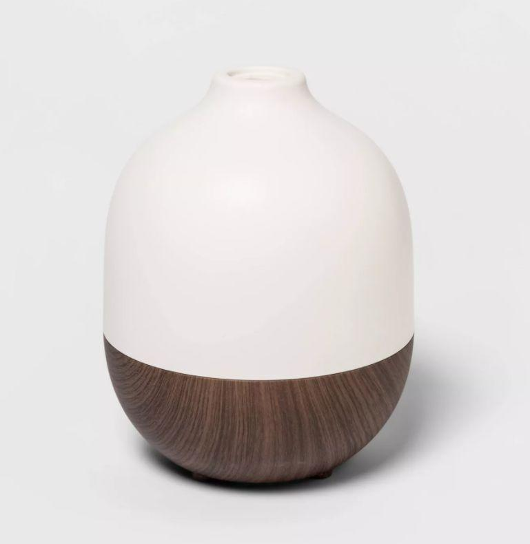 """This diffuser has up to eight hours of vapor and an auto shut-off feature. It has a 4.3-star rating and more than 40 reviews. <a href=""""https://goto.target.com/meXE1"""" target=""""_blank"""" rel=""""noopener noreferrer"""">Find it for $28 at Target</a>."""