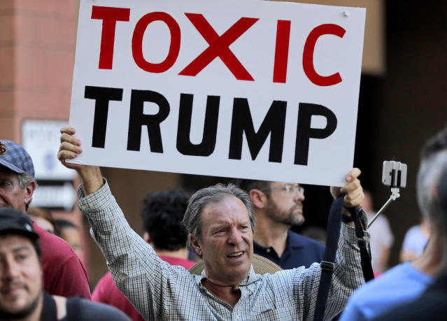 <p>People protest outside the Phoenix Convention Center, Tuesday, Aug. 22, 2017, in Phoenix. Protests were held against President Donald Trump as planned to host a rally inside the convention center. (AP Photo/Matt York) </p>