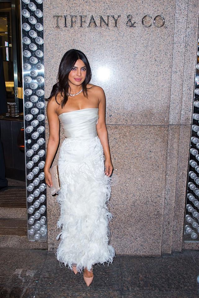"<p>Chopra donned a feathered Marchesa dress for <a rel=""nofollow"" href=""https://www.townandcountrymag.com/the-scene/weddings/a24400152/priyanka-chopra-bridal-shower-at-tiffany-and-cos-blue-box-cafe-dress/"">her over-the-top bridal shower</a> at Tiffany & Co.'s Blue Box Cafe.</p>"