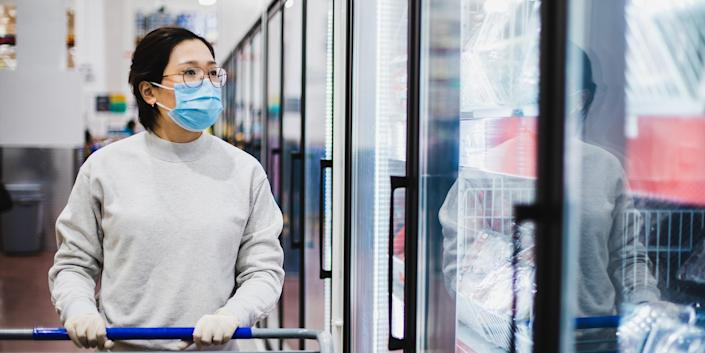 Asian female wearing a face mask shopping at the supermarket (Getty Images stock)