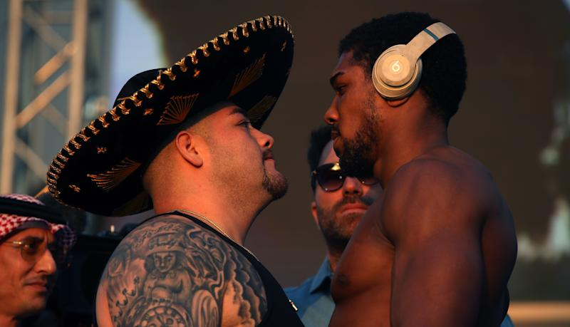 Andy Ruiz Jr (left) and Anthony Joshua during the weigh in at the Al Faisaliah Hotel in Riyadh, Saudi Arabia.