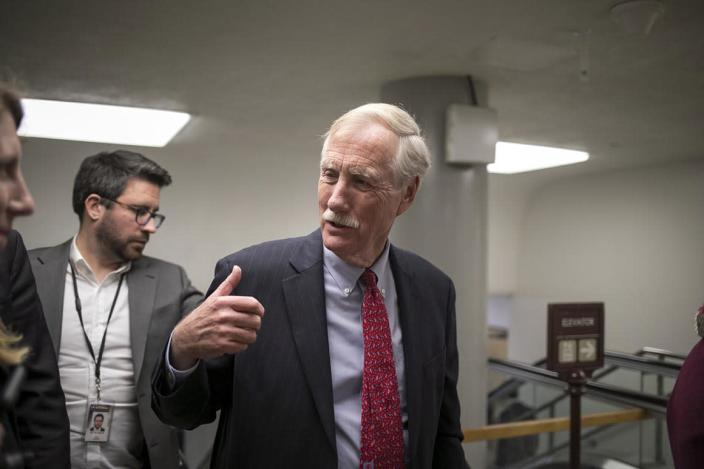 Sen. Angus King, I-Maine, and other senators arrive to vote on the confirmation of Samuel Brownback, governor of Kansas and a former U.S. senator, to become the ambassador-at-large for international religious freedom, at the Capitol in Washington, Wednesday, Jan. 24, 2018. (AP Photo/J. Scott Applewhite)