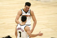 Denver Nuggets forward Michael Porter Jr., top, congratulates guard Facundo Campazzo after Campazzo hit a three-point shot during the second half of an NBA basketball game against the Los Angeles Clippers Saturday, May 1, 2021, in Los Angeles. (AP Photo/Mark J. Terrill)