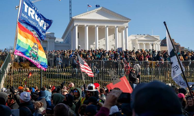 Guns rights supporters gather outside the state capitol in Richmond, Virginia, on 20 January.