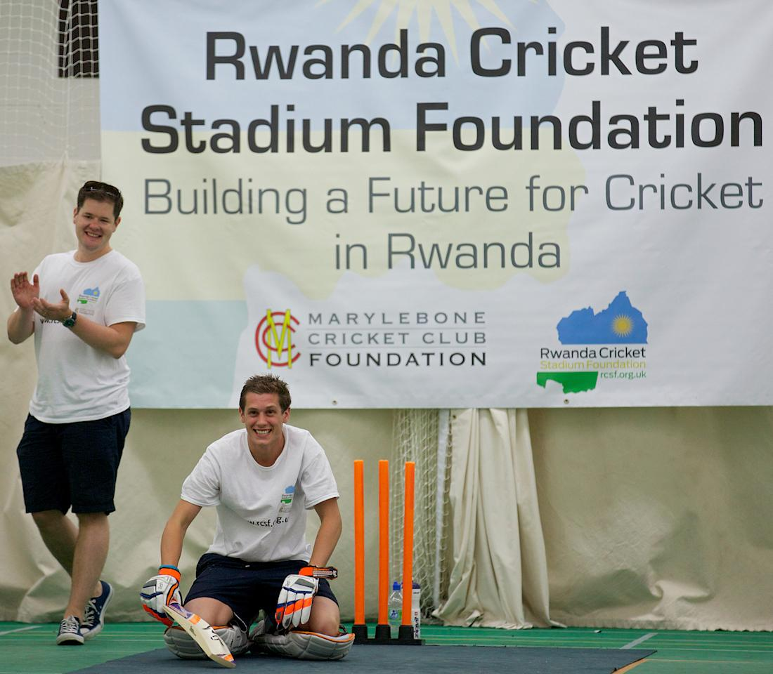 Alby Shale (2nd L) celebrates after batting for 26 hours at the Oval cricket club in London, on July 16, 2013. A British graduate collapsed in a heap on Tuesday at The Oval cricket ground in London after batting for 26 hours in a bid to break the world record. The attempt was in aid of the Rwanda Cricket Stadium Foundation -- a charity set up to build the first proper cricket ground in the African country. AFP PHOTO / ANDREW COWIE