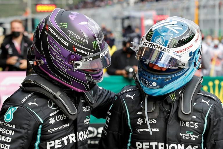 Mercedes drivers Lewis Hamilton and Valtteri Bottas (R) compare notes after finishing first and second in qualifying (AFP/UMIT BEKTAS)